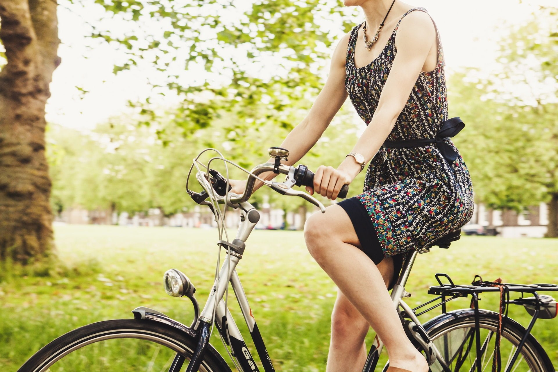 person wearing black and gray sleeveless dress riding a step through bicycle 1